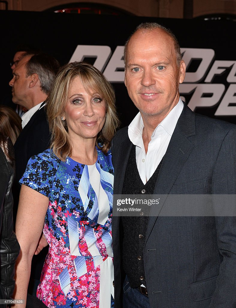 Co-Chairman & CEO of DreamWorks Stacey Snider (L) and actor Michael Keaton arrive at the premiere of DreamWorks Pictures' 'Need For Speed' at TCL Chinese Theatre on March 6, 2014 in Hollywood, California.