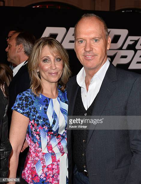 CoChairman CEO of DreamWorks Stacey Snider and actor Michael Keaton arrive at the premiere of DreamWorks Pictures' 'Need For Speed' at TCL Chinese...