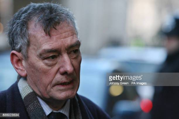 Cochairman of the Consultative Group on the Past report Denis Bradley speaks to the press as he and his cochairman Lord Eames leave 10 Downing Street...