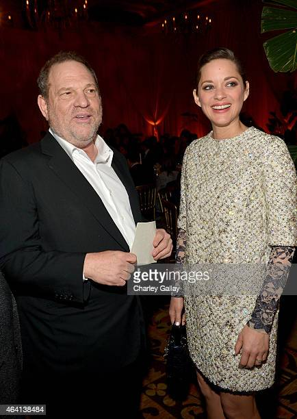 CoChairman of The Weinstein Company Harvey Weinstein and actress Marion Cotillard attend The Weinstein Company's Academy Awards Nominees Dinner in...