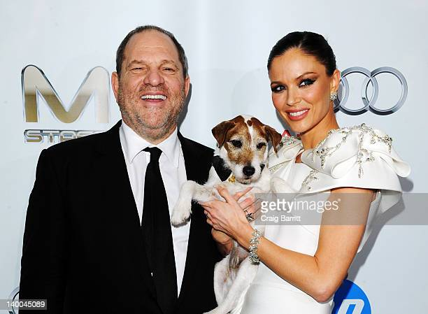 CoChairman of The Weinstein Company Harvey Weinstein Uggie the dog and designer Georgina Chapman attend TWC Oscar after party in partnership with...