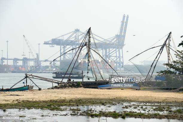 Cochin Lagoon in Kerala Chinese fishing nets and the oil and gas company Wipro in background in the port city of Kochi in the state of Kerala on...