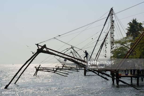 Cochin Lagoon in Kerala Chinese fishing nets on the lagoon in Kochi Kerala on January 18 2017 in India