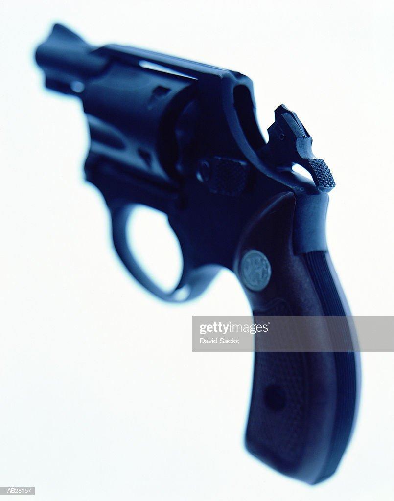 Cocked hand gun, close-up : Stock Photo