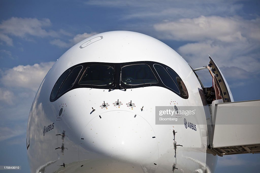 Cockpit windows sit above the nose of an Airbus SAS A350, produced by a unit of European Aeronautic, Defence & Space Co. (EADS), following its first flight in Toulouse, France, on Friday, June 14, 2013. Airbus SAS's new A350 wide-body returned from its maiden flight after a four-hour airborne test of the long-range airliner, in a show of confidence that the jet can enter service in late 2014 and challenge Boeing Co. Photographer: Balint Porneczi/Bloomberg via Getty Images