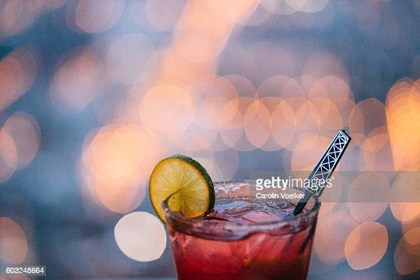 Cocktail at the edge of a rooftop terrace with view at Chicago
