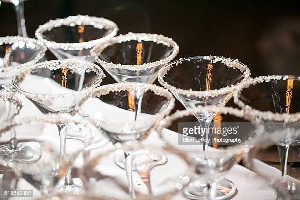 Cocktail glasses at night with salt rim