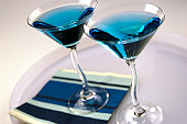 Cocktail glasses containing blue drink, close up