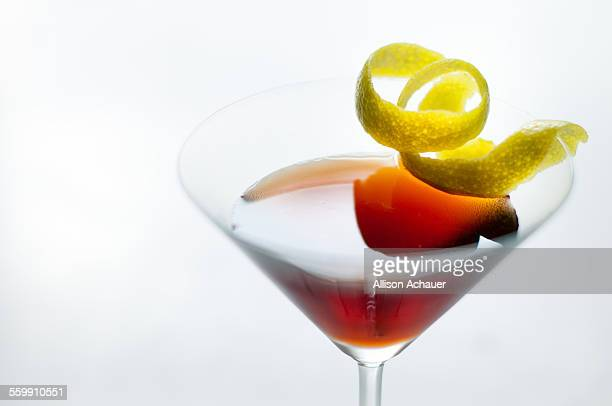 Cocktail in martini glass with lime twist