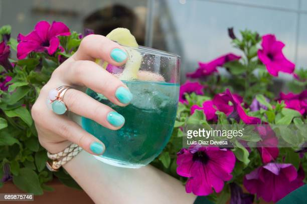 Cocktail In Woman Hand With green nails