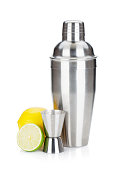 Cocktail shaker with maeasuring cup and citruses. Isolated on white background
