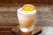 """Cocktail on the basis of bourbon and lemon juice. Bar background for the menu. Space for text""""n"""