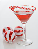Cocktail with candy cane and Christmas ornaments
