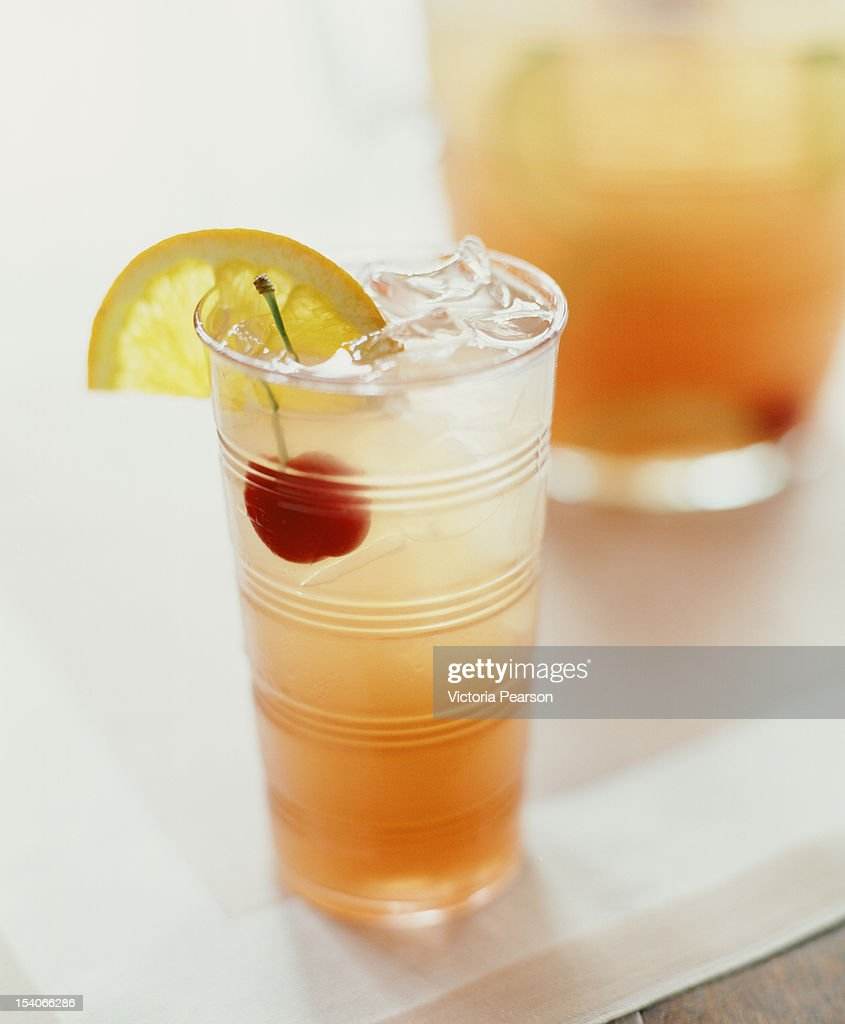 Cocktail with cherry and orange slice. : Stock Photo