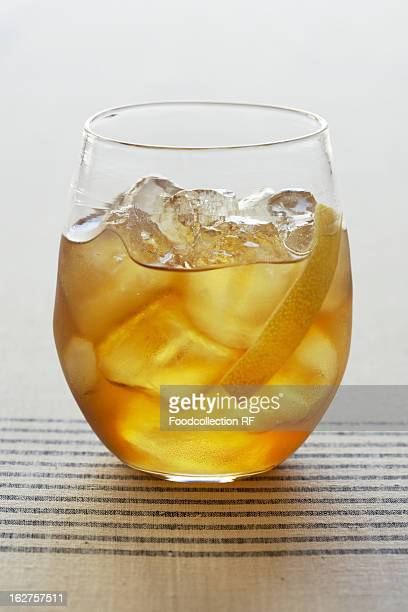 Cocktail with lemon peel and ice