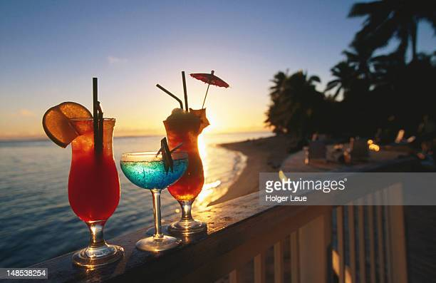Cocktails on balcony at sunset, Rarotongan Beach Resort.