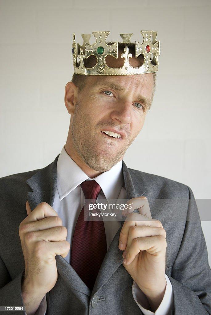 Cocky Businessman Wears Crown