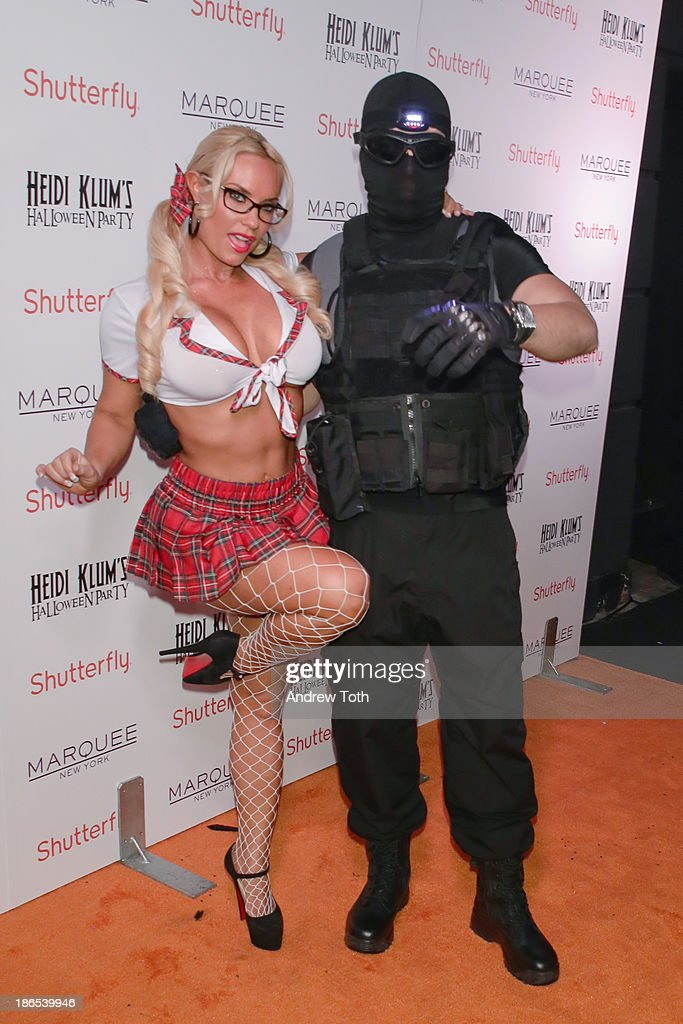 <a gi-track='captionPersonalityLinkClicked' href=/galleries/search?phrase=Coco+Austin&family=editorial&specificpeople=207511 ng-click='$event.stopPropagation()'>Coco Austin</a> (Coco-T) and <a gi-track='captionPersonalityLinkClicked' href=/galleries/search?phrase=Ice-T&family=editorial&specificpeople=213017 ng-click='$event.stopPropagation()'>Ice-T</a> (R) attend the 2013 Heidi Klum Halloween Party at Marquee on October 31, 2013 in New York City.