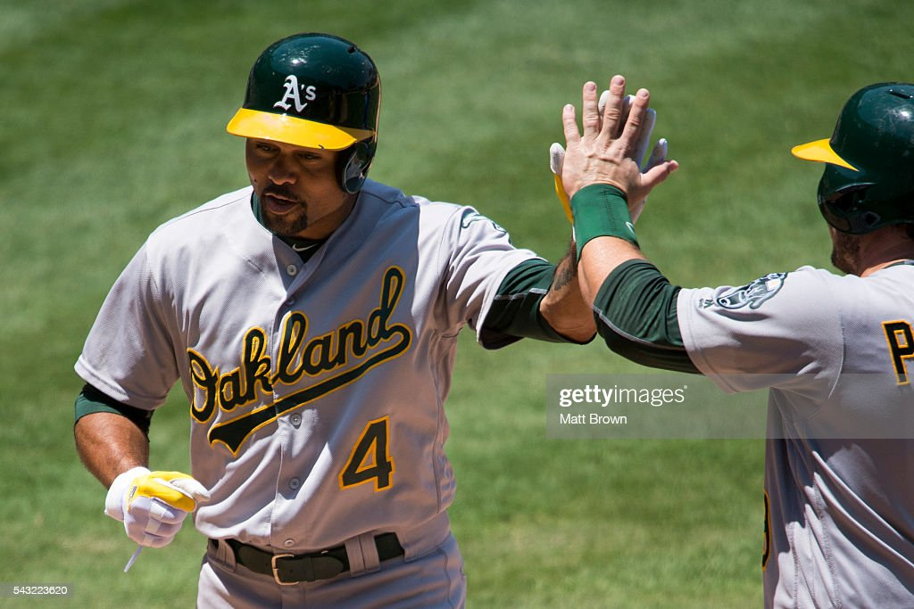 <a gi-track='captionPersonalityLinkClicked' href=/galleries/search?phrase=Coco+Crisp&family=editorial&specificpeople=206376 ng-click='$event.stopPropagation()'>Coco Crisp</a> #4 and <a gi-track='captionPersonalityLinkClicked' href=/galleries/search?phrase=Josh+Phegley&family=editorial&specificpeople=6796472 ng-click='$event.stopPropagation()'>Josh Phegley</a> #19 of the Oakland Athletics celebrate after Crsip hit a grand slam during the fourth inning of the game against the Los Angeles Angels of Anaheim at Angel Stadium of Anaheim on June 26, 2016 in Anaheim, California.