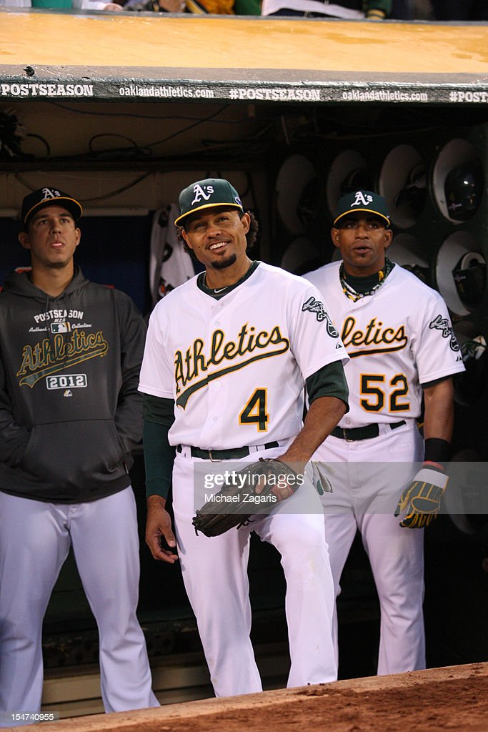 Coco Crisp #4 and Yoenis Cespedes #52 of the Oakland Athletics wait to take the field prior to the game against the Detroit Tigers at the Oakland-Alameda County Coliseum on October 11, 2012 in Oakland, California. The Tigers defeated the Athletics 6-0.