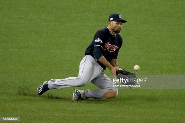 Coco Crisp of the Cleveland Indians catches a fly ball in left field hit by Josh Donaldson of the Toronto Blue Jays to end the seventh inning during...