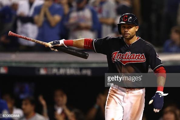Coco Crisp of the Cleveland Indians celebrates after scoring a run on an RBI single hit by Carlos Santana during the third inning against the Chicago...