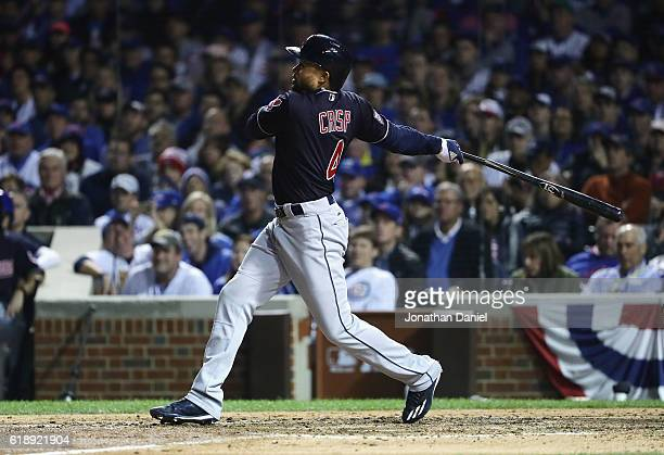 Coco Crisp of the Cleveland Indians hits a single in the seventh inning against the Chicago Cubs in Game Three of the 2016 World Series at Wrigley...