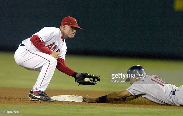 Coco Crisp of the Cleveland Indians slides into second beneath tag of David Eckstein of the Anaheim Angels in the fourth inning of 85 victory at...