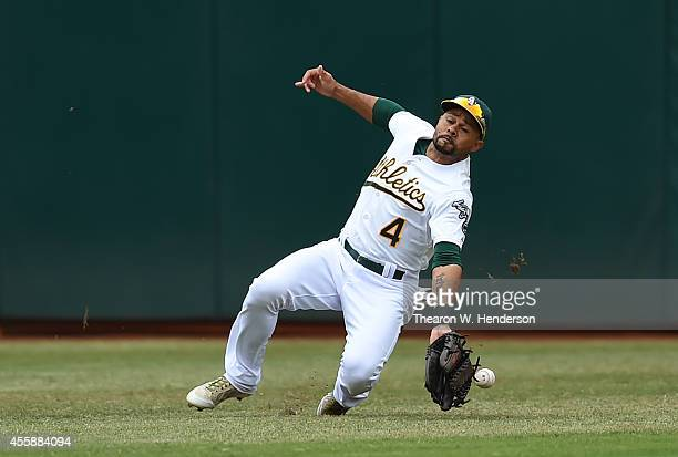 Coco Crisp of the Oakland Athletics can't make the catch that went for a double off the bat of Ryan Howard of the Philadelphia Phillies in the top of...