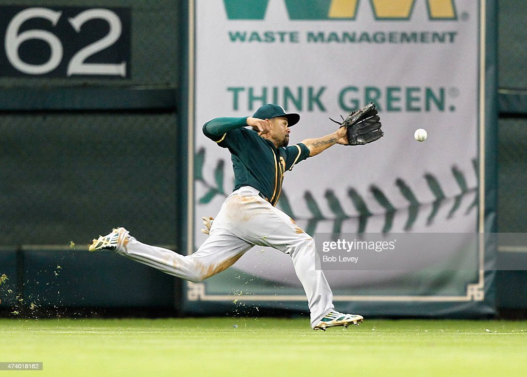 <a gi-track='captionPersonalityLinkClicked' href=/galleries/search?phrase=Coco+Crisp&family=editorial&specificpeople=206376 ng-click='$event.stopPropagation()'>Coco Crisp</a> #4 of the Oakland Athletics can't track down this line drive off the bat of Colby Rasmus of the Houston Astros in the second inning at Minute Maid Park on May 19, 2015 in Houston, Texas.