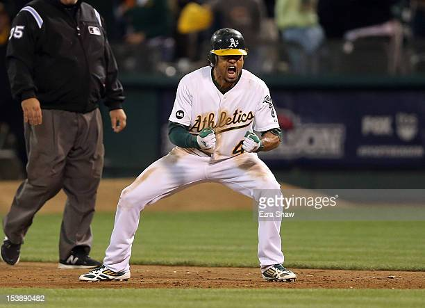 Coco Crisp of the Oakland Athletics celebrates after he hit a gamewinning single to beat the Detroit Tigers in the ninth inning of Game Four of the...