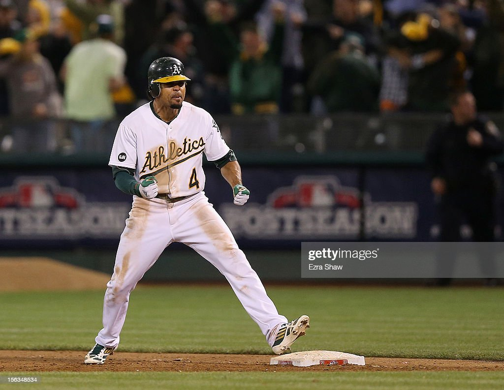 Coco Crisp #4 of the Oakland Athletics celebrates after he hit a game-winning single to beat the Detroit Tigers in the ninth inning of Game Four of the American League Division Series at Oakland-Alameda County Coliseum on October 9, 2012 in Oakland, California.