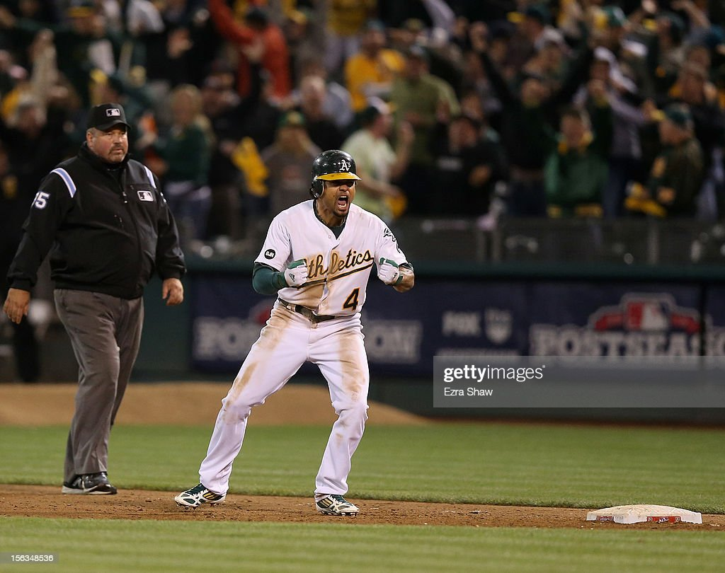 <a gi-track='captionPersonalityLinkClicked' href=/galleries/search?phrase=Coco+Crisp&family=editorial&specificpeople=206376 ng-click='$event.stopPropagation()'>Coco Crisp</a> #4 of the Oakland Athletics celebrates after he hit a game-winning single to beat the Detroit Tigers in the ninth inning of Game Four of the American League Division Series at Oakland-Alameda County Coliseum on October 9, 2012 in Oakland, California.