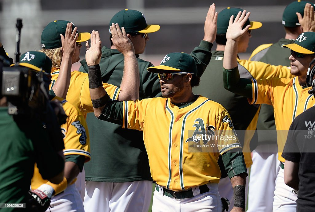 Coco Crisp #4 of the Oakland Athletics celebrates with his teammates defeating the Chicago White Sox 2-0 at O.co Coliseum on June 2, 2013 in Oakland, California.