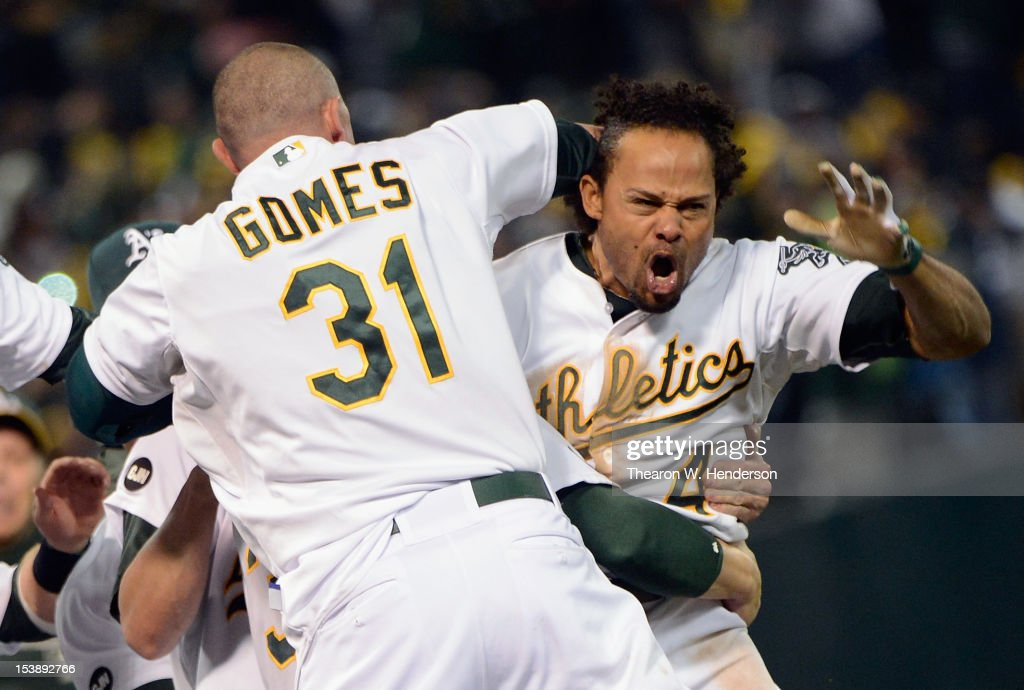 <a gi-track='captionPersonalityLinkClicked' href=/galleries/search?phrase=Coco+Crisp&family=editorial&specificpeople=206376 ng-click='$event.stopPropagation()'>Coco Crisp</a> #4 of the Oakland Athletics celebrates with the team after hitting a walkoff single against the Detroit Tigers during Game Four of the American League Division Series at Oakland-Alameda County Coliseum on October 10, 2012 in Oakland, California.