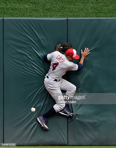 Coco Crisp of the Oakland Athletics crashed into the center field wall after missing a catch of the ball hit by Eddie Rosario of the Minnesota Twins...