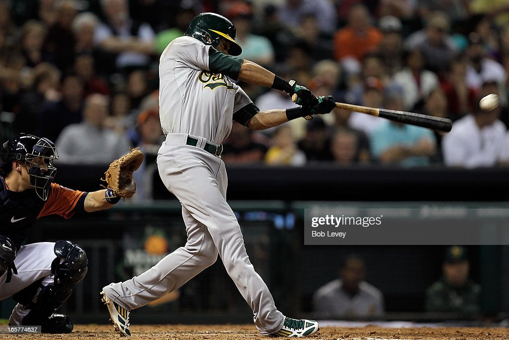 <a gi-track='captionPersonalityLinkClicked' href=/galleries/search?phrase=Coco+Crisp&family=editorial&specificpeople=206376 ng-click='$event.stopPropagation()'>Coco Crisp</a> #4 of the Oakland Athletics doubles in the fifth inning against the Oakland Athletics at Minute Maid Park on April 5, 2013 in Houston, Texas.