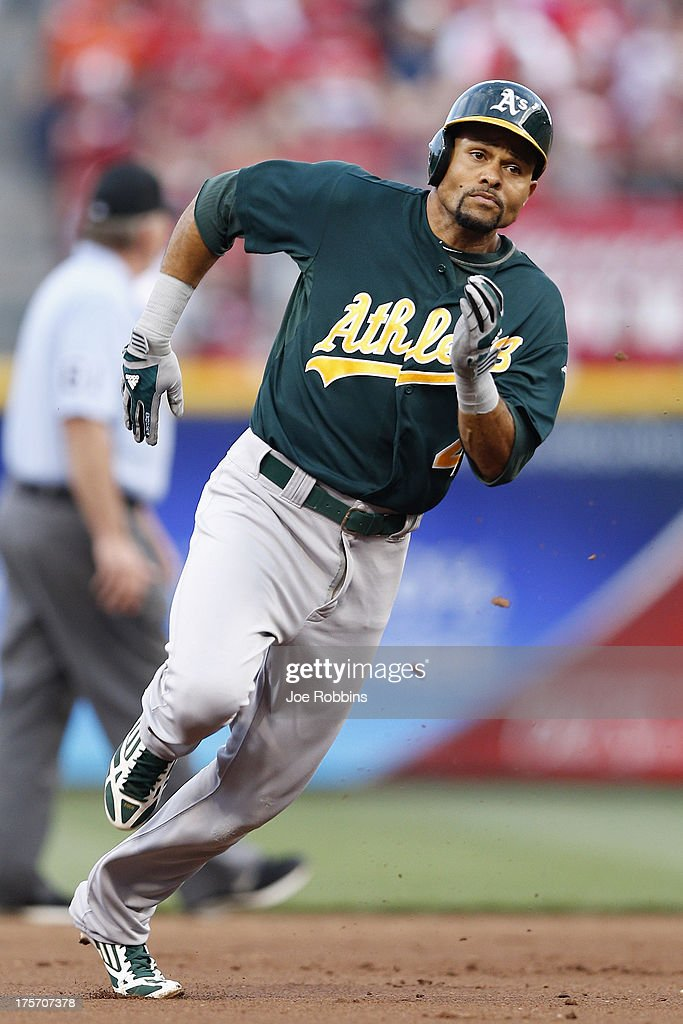 <a gi-track='captionPersonalityLinkClicked' href=/galleries/search?phrase=Coco+Crisp&family=editorial&specificpeople=206376 ng-click='$event.stopPropagation()'>Coco Crisp</a> #4 of the Oakland Athletics heads toward third base with a triple in the third inning of the game against the Cincinnati Reds at Great American Ball Park on August 6, 2013 in Cincinnati, Ohio.