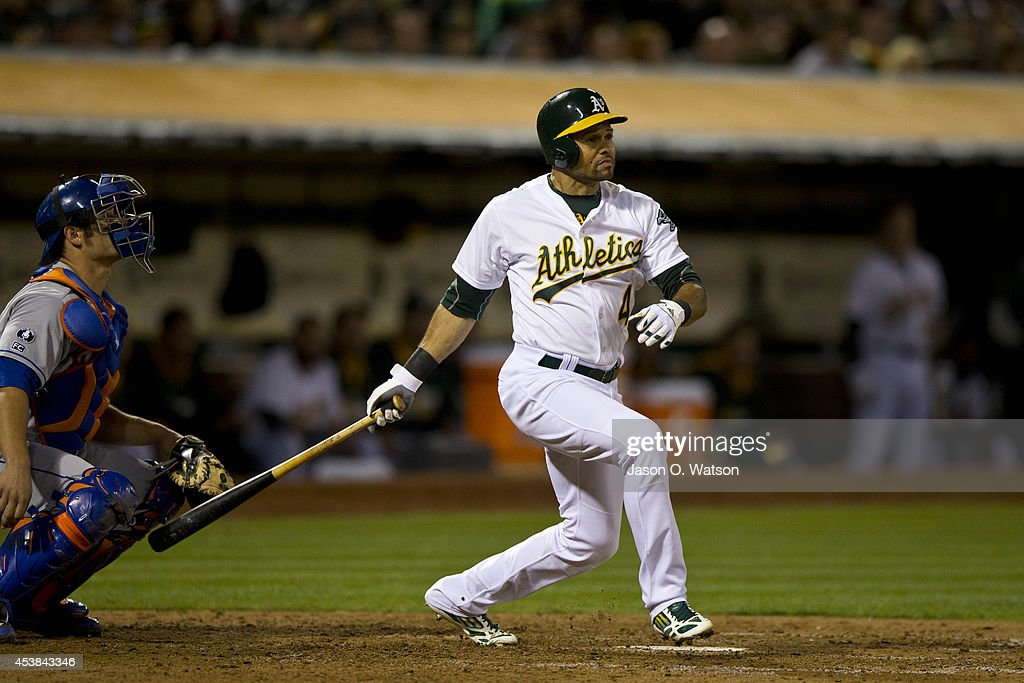 <a gi-track='captionPersonalityLinkClicked' href=/galleries/search?phrase=Coco+Crisp&family=editorial&specificpeople=206376 ng-click='$event.stopPropagation()'>Coco Crisp</a> #4 of the Oakland Athletics hits a three run triple against the New York Mets during the fourth inning of an interleague game at O.co Coliseum on August 19, 2014 in Oakland, California.