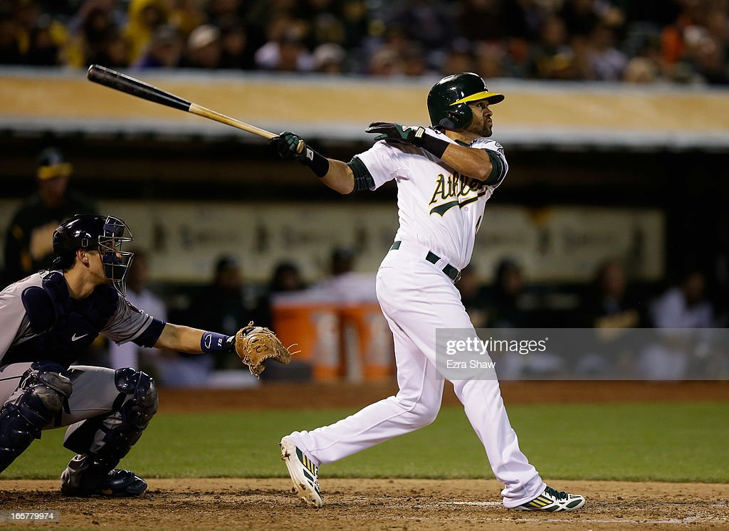 Coco Crisp #4 of the Oakland Athletics hits a triple that scored Eric Sogard #28 in the fifth inning of their game against the Houston Astros at O.co Coliseum on April 16, 2013 in Oakland, California.