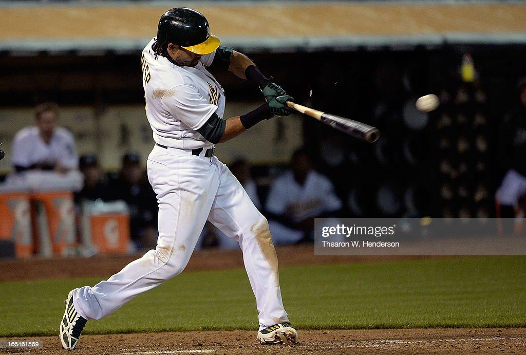 <a gi-track='captionPersonalityLinkClicked' href=/galleries/search?phrase=Coco+Crisp&family=editorial&specificpeople=206376 ng-click='$event.stopPropagation()'>Coco Crisp</a> #4 of the Oakland Athletics hits an RBI single driving in teammate Josh Donaldson #20 against the Detroit Tigers in the seventh inning at O.co Coliseum on April 12, 2013 in Oakland, California.