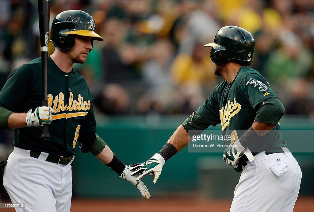 <a gi-track='captionPersonalityLinkClicked' href=/galleries/search?phrase=Coco+Crisp&family=editorial&specificpeople=206376 ng-click='$event.stopPropagation()'>Coco Crisp</a> #4 of the Oakland Athletics is congratulated by <a gi-track='captionPersonalityLinkClicked' href=/galleries/search?phrase=Jed+Lowrie&family=editorial&specificpeople=4949369 ng-click='$event.stopPropagation()'>Jed Lowrie</a> #8 after Crisp hit a lead off home run against the New York Yankees in the first inning at O.co Coliseum on June 11, 2013 in Oakland, California.