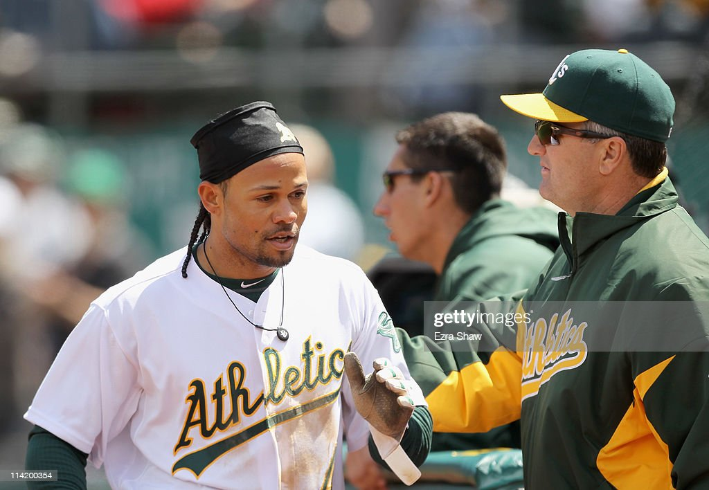 <a gi-track='captionPersonalityLinkClicked' href=/galleries/search?phrase=Coco+Crisp&family=editorial&specificpeople=206376 ng-click='$event.stopPropagation()'>Coco Crisp</a> #4 of the Oakland Athletics is congratulated by manager Bob Geren after he hit a home run in the fifth inning against the Chicago White Sox at Oakland-Alameda County Coliseum on May 15, 2011 in Oakland, California.