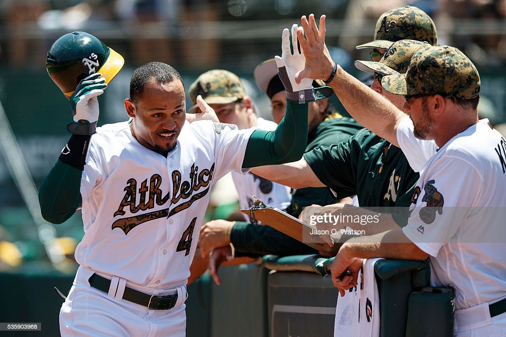 <a gi-track='captionPersonalityLinkClicked' href=/galleries/search?phrase=Coco+Crisp&family=editorial&specificpeople=206376 ng-click='$event.stopPropagation()'>Coco Crisp</a> #4 of the Oakland Athletics is congratulated by teammates after hitting a home run against the Minnesota Twins during the first inning at the Oakland Coliseum on May 30, 2016 in Oakland, California.