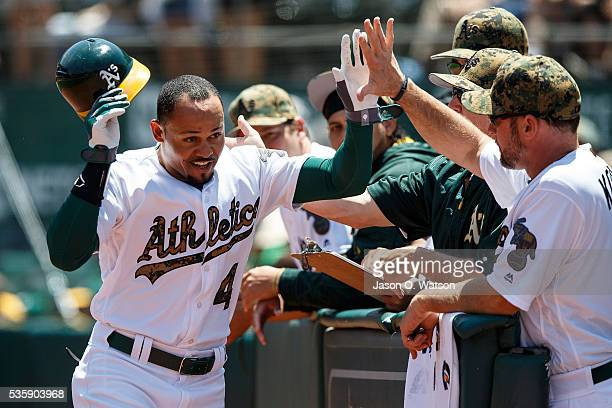 Coco Crisp of the Oakland Athletics is congratulated by teammates after hitting a home run against the Minnesota Twins during the first inning at the...