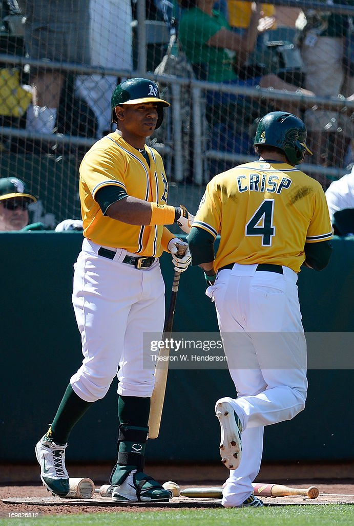 <a gi-track='captionPersonalityLinkClicked' href=/galleries/search?phrase=Coco+Crisp&family=editorial&specificpeople=206376 ng-click='$event.stopPropagation()'>Coco Crisp</a> #4 of the Oakland Athletics is congratulated by <a gi-track='captionPersonalityLinkClicked' href=/galleries/search?phrase=Yoenis+Cespedes&family=editorial&specificpeople=8892047 ng-click='$event.stopPropagation()'>Yoenis Cespedes</a> #52 after Crisp scored during the eighth inning against the Chicago Whites Sox at O.co Coliseum on June 2, 2013 in Oakland, California. The Athletics defeated the White Sox 2-0.