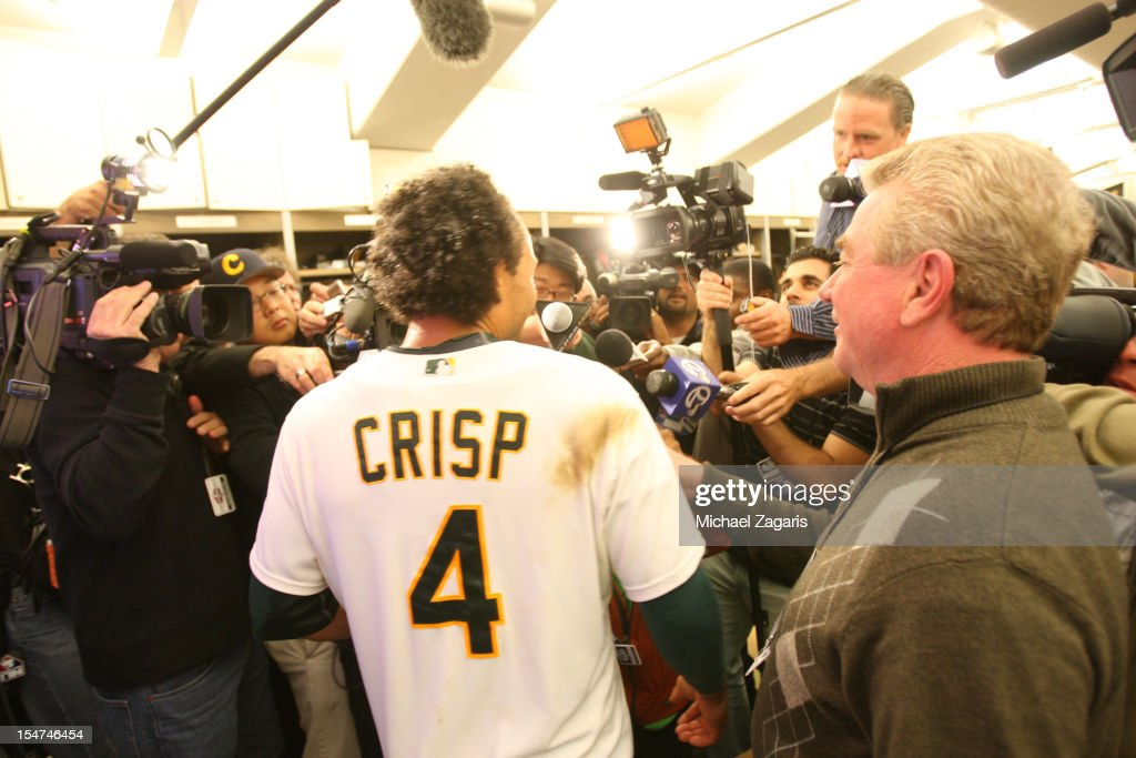 Coco Crisp #4 of the Oakland Athletics is interviewed in the clubhouse following the game against the Detroit Tigers at the Oakland-Alameda County Coliseum on October 10, 2012 in Oakland, California. The Athletics defeated the Tigers 4-3.