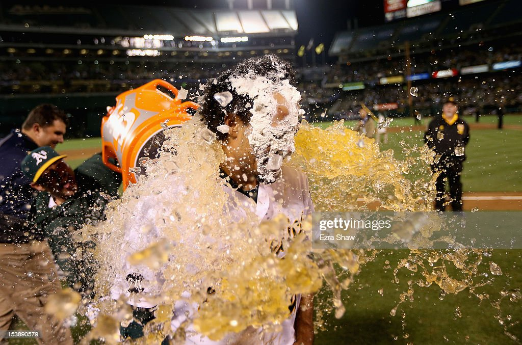 <a gi-track='captionPersonalityLinkClicked' href=/galleries/search?phrase=Coco+Crisp&family=editorial&specificpeople=206376 ng-click='$event.stopPropagation()'>Coco Crisp</a> #4 of the Oakland Athletics is soaked with Gatorade after he had a pie put over his face after he hit a game-winning single to beat the Detroit Tigers in the ninth inning of Game Four of the American League Division Series at Oakland-Alameda County Coliseum on October 9, 2012 in Oakland, California.