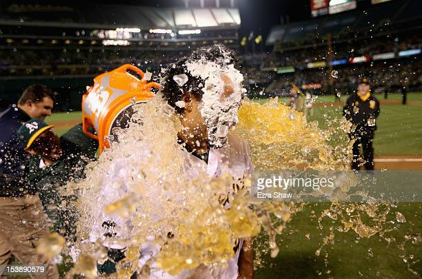 Coco Crisp of the Oakland Athletics is soaked with Gatorade after he had a pie put over his face after he hit a gamewinning single to beat the...