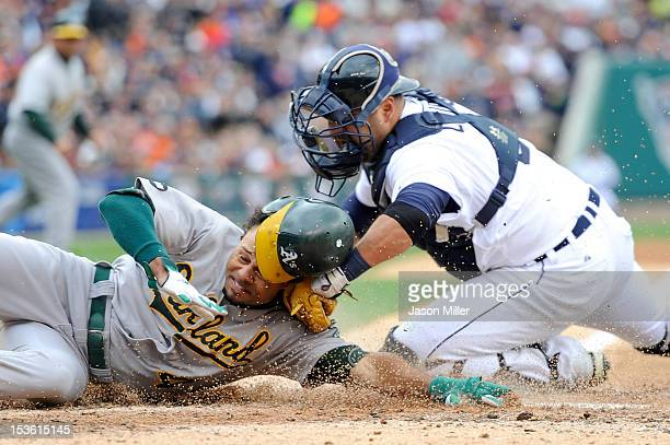 Coco Crisp of the Oakland Athletics is tagged out at home Gerald Laird of the Detroit Tigers in the top of the third inning during Game Two of the...